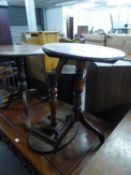AN EARLY 19TH CENTURY MAHOGANY CIRCULAR TRIPOD TABLE AND ANOTHER WITH OVAL TOP (A.F.) (2)