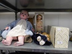 A LARGE COMPOSITION BABY DOLL WITH SLEEPING EYES, DRESSED (TORTOISE TRADE MARK) AND FOUR MODERN