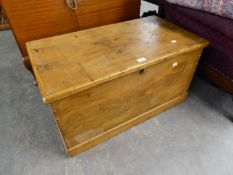 A NINETEENTH CENTURY PINE CHEST WITH LIFT-UP TOP