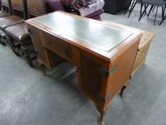 A DYNATRON WALNUT AND MAHOGANY CROSSBANDED RADIOGRAM, IN THE FORM OF A PEDESTAL DESK WITH GREEN