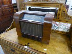 A VINTAGE WALNUTWOOD CASED VALVE MAINS RADIO