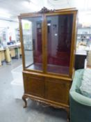 A CARVED AND FIGURED WALNUT DISPLAY CABINET, THE UPPER PORTION WITH TWO GLAZED DOORS AND GLAZED