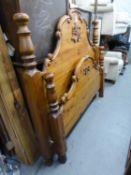 A MODERN CARVED PINE 4?6? PANEL BEDSTEAD, WITH SLATTED WOOD BASE
