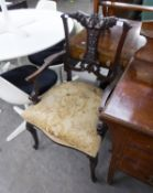AN EDWARDIAN MAHOGANY ARMCHAIR, HAVING CARVED BACK AND UPHOLSTERED SEAT ON CABRIOLE FRONT LEGS