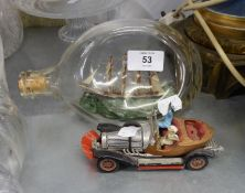 A SHIP IN A BOTTLE AND CORGI TOY ?CHITTY CHITTY BANG BANG? DIE CAST TOY CAR WITH TWO FIGURES (AS