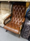 A REPRODUCTION BROWN LEATHER UPHOLSTERED REGENCY REVIVAL CHAIR (BOTH BACK LEGS HAVING BEEN