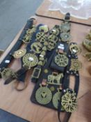 SEVEN LEATHER STRAPS WITH OLD HORSE BRASSES