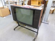 BANG AND OLUFSEN 'BEOVISION LX2500' COLOUR TELEVISION ON STAND, HAVING REMOTE CONTROL AND TWO