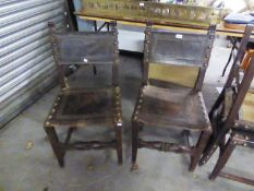 A SET OF FOUR OAK DINING CHAIRS, WITH LEATHER AND STUDS TO THE SEATS AND BACKS (4)