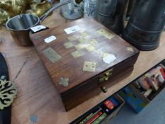 A WALNUTWOOD AND BRASS INLAID GAMES BOX, CONTAINING A SET OF DOMINOES, CHESS ETC...