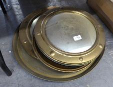 FOUR PAIRS OF VARIOUS BRASS FRAMED CONVEX WALL MIRRORS AND AN ORIENTAL EMBOSSED BRASS CIRCULAR