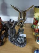 A GILT FINISH RESIN MODEL OF AN EAGLE AND A METAL CAR MASCOT STYLE MODEL OF AN EAGLE, ON MARBLE