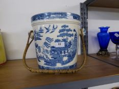 POTTERY WILLOW PATTERN SLOPS PAIL WITH CANE BOUND SWING HANDLE
