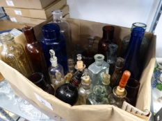 COLLECTION OF VINTAGE GLASS BOTTLES, some coloured and a few with stoppers, contents of a small box