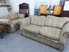 TWO MATCHING SETTEES WITH LOW BACKS, OUT-SCROLLED ARMS, SHAPED CUSHIONS, COVERED IN COSTLY GREEN AND
