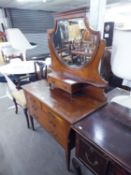 AN EDWARDIAN INLAID MAHOGANY DRESSING TABLE WITH SHIELD SHAPED MIRROR, TWO OVER THREE DRAWERS AND