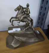A METAL EQUESTRIAN GROUP ON ROCKWORK STYLE BASE