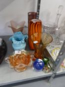 AN ORANGE STRIPED GLASS VASE; A PALE BLUE OPAQUE GLASS VASE WITH FRILL TOP AND MISCELLANEOUS