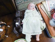 COMPOSITION BLACK BABY DOLL with fixed eyes and moveable limbs, 9 ½? high, (a/f), together with