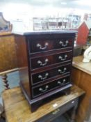 MAHOGANY REPRODUCTION SMALL CHEST OF FOUR DRAWERS ON BRACKET FEET