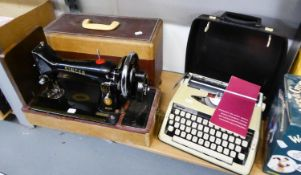 VINTAGE BLACK AND GILT SINGER SEWING MACHINE, EM904365, in carrying case, together with a BROTHER