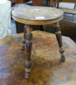 A PEN WORK DECORATED STOOL WITH CIRCULAR PANEL SEAT, ON THREE TURNED LEGS