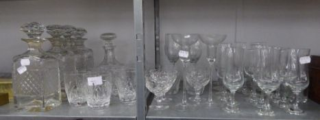 A SET OF FOUR CUT GLASS SQUARE SPIRIT DECANTERS, ANOTHER DECANTER (SOME A.F.) AND A QUANTITY OF
