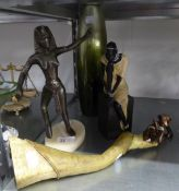A RESIN FIGURE OF A TALL, SLENDER AFRICAN WOMAN; A RESIN FIGURE OF AN AFRICAN WOMAN SEATED ON A