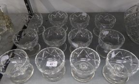 A SET OF TWELVE CUT GLASS SUNDAE DISHES ON SAUCER  SHAPED BASES