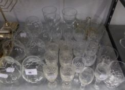 A SET OF SIX WELL-CUT GLASS SHERRY GLASSES AND SEVEN CUT GLASS BRANDY BALLOONS AND FIFTEEN VARIOUS