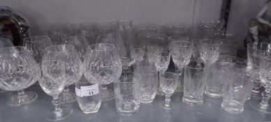 A GOOD SELECTION OF CUT GLASS DRINKING GLASSES TO INCLUDE; 12 BRANDY BALLOONS, SUNDAE DISHES ETC....