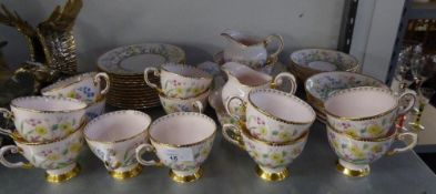 A TUSCAN PINK FLORAL CHINTZ TEA SET FOR 12 PERSONS, CONSISTING; OF TWO CAKE/SANDWICH PLATES, TWO
