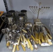 AN ELECTROPLATE ART DECO ENTRÉE DISH WITH IVORINE HANDLES; AN ELECTROPLATE MENORAH; A SET OF FOUR