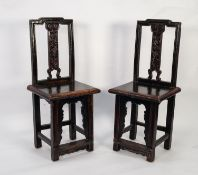 AGED PAIR OF CHINESE CARVED HARDWOOD SINGLE CHAIRS, each with moulded back and floral carved splat