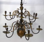 EARLY TWENTIETH CENTURY DUTCH TWELVE BRANCH BRASS ELECTROLIER, of typical two tier form (6+6),