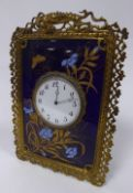 ORNATE LATE VICTORIAN BRASS AND CERAMIC TILE STRUT CLOCK, of oblong form, the 3 ½? enamelled
