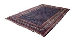 SAROUK PERSIAN LUSTROUS ALL-WOOL HAND KNOTTED CARPET with a dense all-over boteh design on a dark