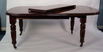 VICTORIAN MAHOGANY WIND-OUT EXTENDING DINING TABLE WITH TWO ADDITIONAL LEAVES, the D end top above a