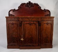 VICTORIAN CARVED AND FIGURED MAHOGANY BREAKFRONT SIDEBOARD, the shaped back outlined with applied,
