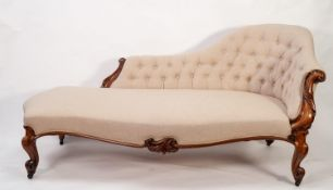GOOD VICTORIAN CARVED WALNUT CHAISE LONGUE, the shaped and buttoned back with scroll carved
