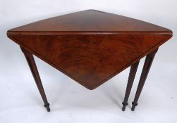 EARLY NINETEENTH CENTURY FLAME CUT MAHOGANY AND EBONY LINE INLAID DROP LEAF CORNER OCCASIONAL TABLE,
