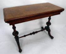 VICTORIAN BURR WALNUT FOLD-OVER CARD TABLE, the rounded oblong swivel top enclosing an oval green