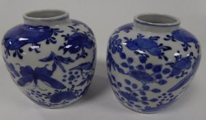 PAIR OF CHINESE BLUE AND WHITE PORCELAIN VASES, each of slightly tapered form with short neck,