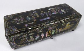 LATE NINETEENTH CENTURY BLACK LACQUERED AND MOTHER OF PEARL INLAID PAPIER MACHE GAMES BOX, of oblong