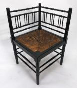 AFTER A DESIGN BY WILLIAM MORRIS, BAMBOO PATTERN EBONISED CORNER CHAIR, of typical form with spindle