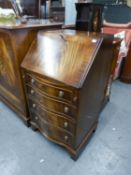 A SMALL REPRODUCTION MAHOGANY SERPENTINE FRONT BUREAU (BEVAN, FUNNELL)