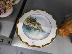 A CHINA PLAQUE, HAND PAINTED WITH AN ITALIAN LAKE SCENE, SIGNED AND DATED J.M. HALKHEAD 1996