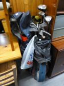 TWO GOLF BAGS, CONTAINING VARIOUS GOLF CLUBS, TO INCLUDE; KING COBRA TITANIUM WOOD, VARIOUS TITLEIST