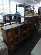 AN OAK SIDE-BY-SIDE DISPLAY CABINET WITH CENTRE SHELVES AND A TEA TROLLEY WITH BARLEY TWIST LEGS (2)