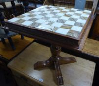 A MODERN OCCASIONAL TABLE WITH TOP SET FOR CHESS